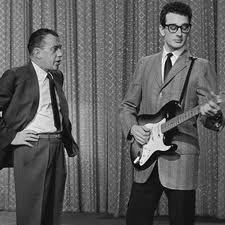 Buddy Holly, looking away from Ed Sullivan in 1958 Buddy Holly Electric Guitar